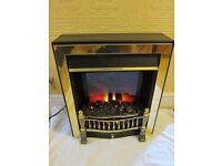 Electric fan heater with flickering coal effect fire, made by Burley of Rutland