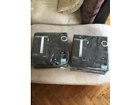 Curtains black suede effect 2 pairs 150-210cm pole x 229cm drop. Never used, still in wrapping.