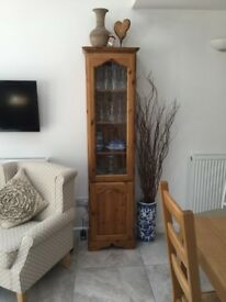 tall pine display cabinet with glazed upper door and solid lower door