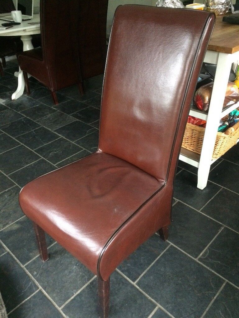 Brown leather dining chairs x 6.