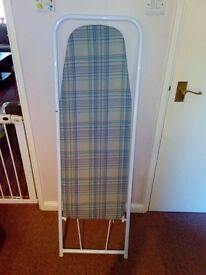 Ironing board (folds up behind door for storage)