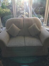 2 seater cream fabric sofa