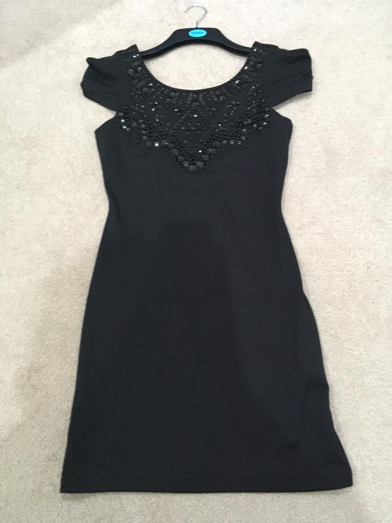 Black Lipsy Dress, size 10in Motherwell, North LanarkshireGumtree - Black Lipsy dress size 10. Lovely detail to the front, capped sleeves, zip to the rear, which goes down in a v shape. Only worn once, excellent condition. Collection only