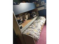 Child's bunk cabin bed with pull out desk ,shelves ,guest bed