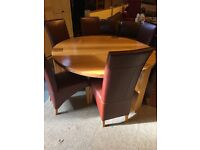 large solid OAK round heavy table and six chairs
