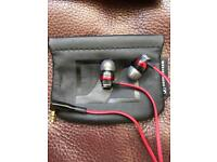 Sennheiser CX3 earbuds with sennheiser leather carry pouch