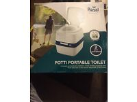 Portable toilet new never used with new bottles of liquid