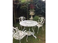 Victorian outdoor metal table with 3 chairs