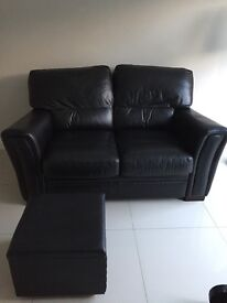 2 seater black leather sofa with matching cube leather foot rest. Excellent condition