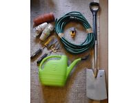 Box of gardening items (Including spade, trowel, fork, hose)