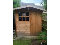 8' x 6' Garden Shed by A&J Sectional Buildings.Georgian Window & locking door.Really good condition.