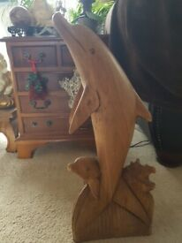 large carved wooden dolphin igure