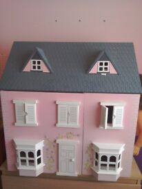 Children's dolls house with furniture.