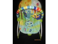Bright Starts Vibrating Baby Rocker/Toddler Chair with toy bar