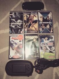 Black PsP, plus case, charger, 3 games, and 3 videos