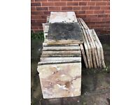 Free. Used slabs but should clean up with a power wash. Free - need gone.