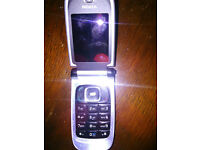 Nokia black flip phone with charger