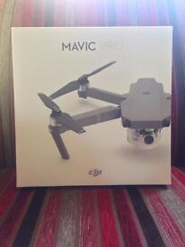 DJI Mavic Pro Drone - New and Sealed - Portable/Powerful, 4K UHD film, 12.35MP, 27 mins flying time!