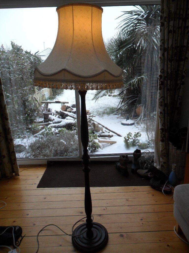 Vintage Floor Standing Lamp. Dark wood turned stand with cream vintage tassled lampshade.