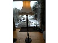 Vintage Floor Standing Lamp. Dark wood turned stand with cream vintage tassled lampshade.