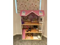 Large dolls house with accessories