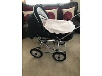 CHURCHILL BLACK BABYS PRAM IN EX CONDITION AS ONLY USED AT GRANS HOUSE