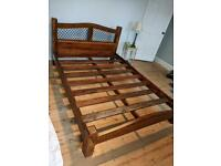 Raj Double Bed made of wood from a rubber tree.