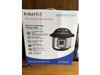 New in box Instant Pot pressure cooker + many extras
