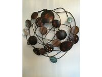 Attractive metal wall sculpture