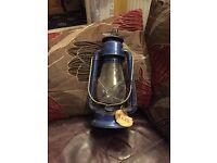 Antique storm lamp
