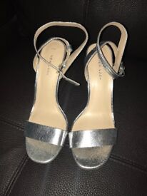 Silver high heels size 7 brand new