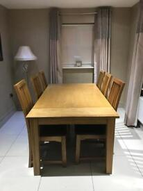 Solid oak dining table & six leather chairs