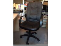 Black faux-leather upholstered exec chair