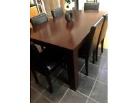 Walnut dinning table and 6faux leather chairs