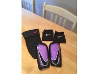 Nike shin pads - size small