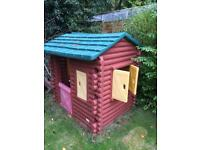 Little tikes log cabin playhouse.