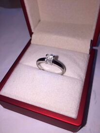 Platinum diamond ring, princess cut, 0.20ct diamonds, valuation and box present.
