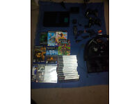 PS2 BLACK WITH 23 GAMES AND EXTRAS