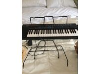 Keyboard for sale VGC with 2 music stands and cable a real bargain at £20