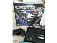 Original Sega megadrive still in box with games