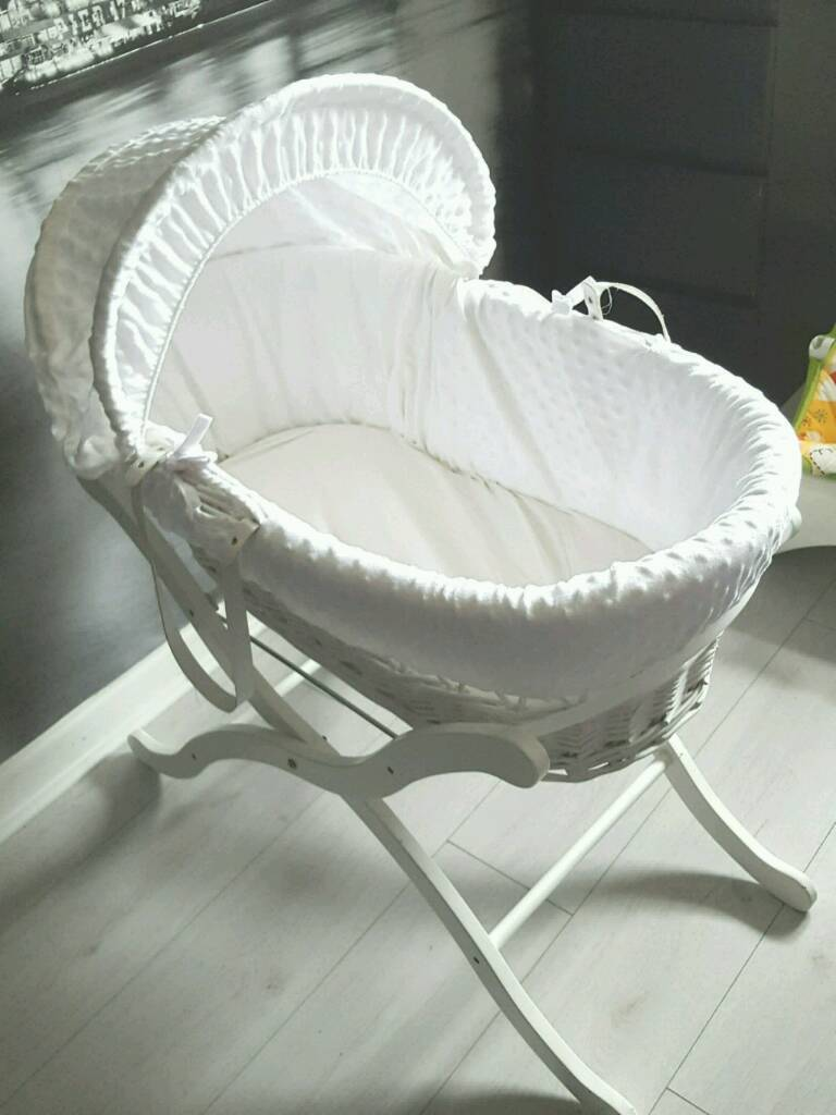 White wicker Moses Basket with stand free baby monitor and blankets