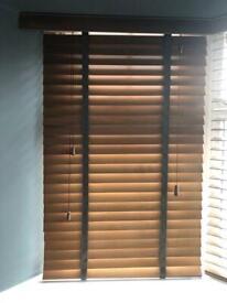 Window blinds. Faux wood