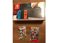 Brand new Nintendo switch + 2 top games Full warranty and receipt