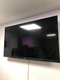 "50"" TV and wall bracket"