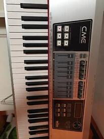 CME 88 weighted Key Midi controller keyboard.