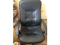 Black office chair. Can be lowered or raised and swivels . Very comfortable seat.