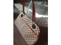 Gucci Bag with genuine leather piping and handles