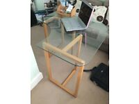 Glass topped table on trestle legs, surface 1 metre squared