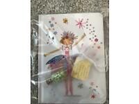 Little girls fairy notepad and fairy dust