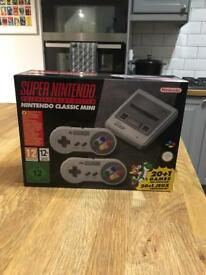 BRAND NEW NINTENDO SNES MINI CONSOLE WITH 2 CONTROLLERS.